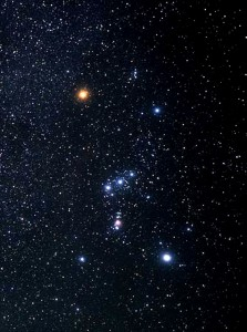 This is Orion. The red star is Betelgeuse. The opposite blue star is Orion. The Orion Nebula is the sword hanging down from his belt. From Constellation Guide via Hubble.