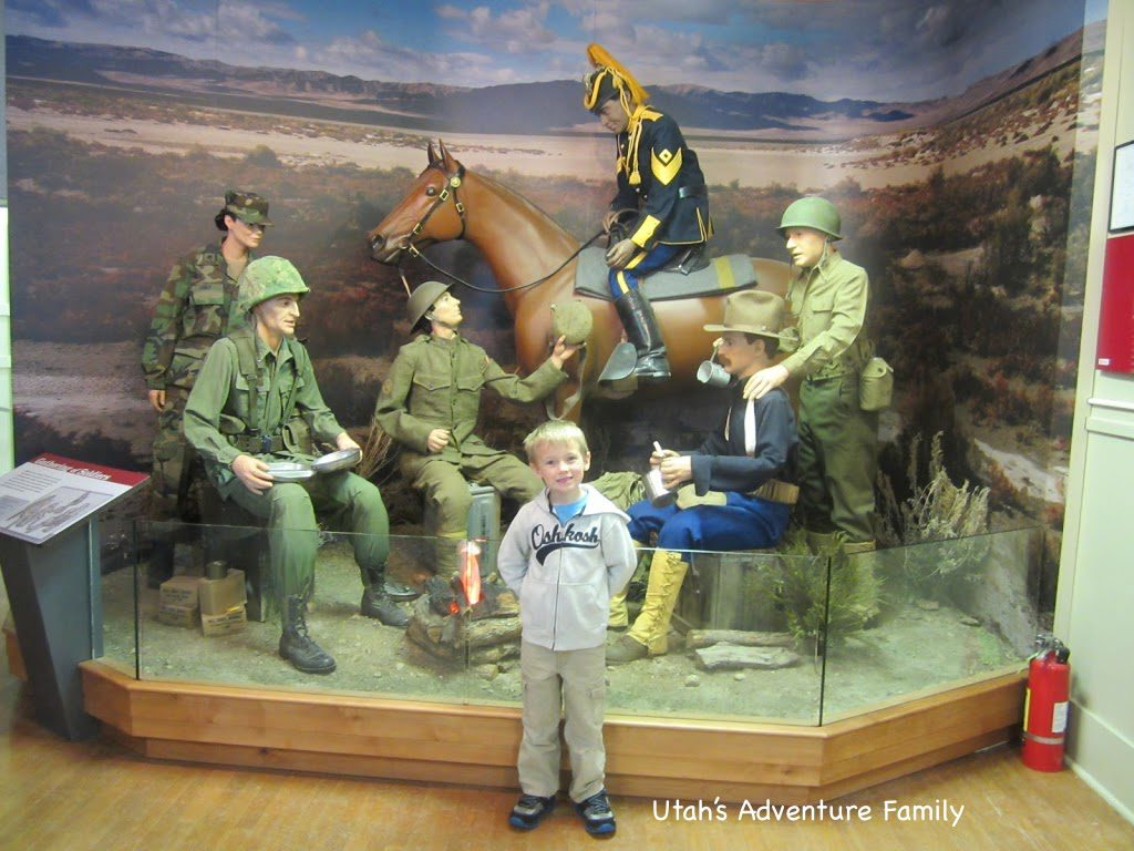 The first display shows soldiers from different wars.