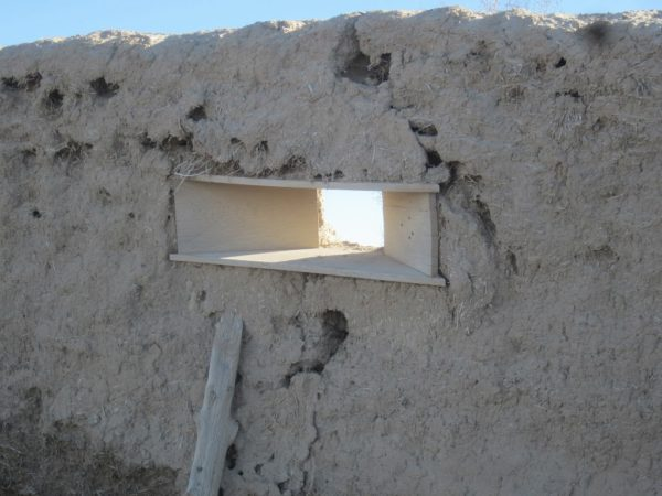 Small window in the adobe wall of fort deseret