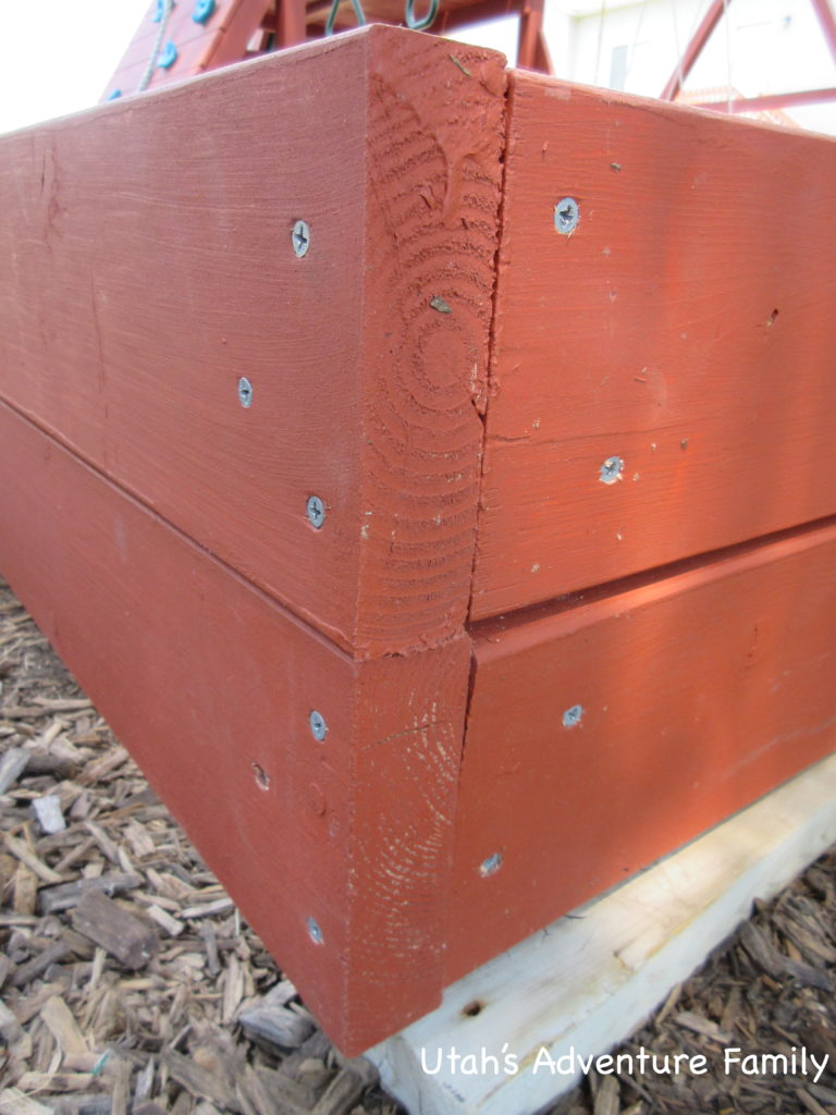 The board on the left is the 5 footer. In this corner, the 2x4 on the inside has the flat side against the 8 footer. So on the left, only 2 screws go into the 2x4, the other 4 go into the 8 footer. Notice the screws are not aligned.