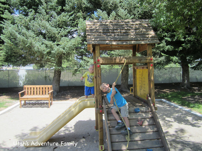 There is a small playground near the picnic tables.