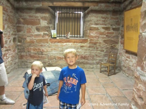 kids standing in an old jail