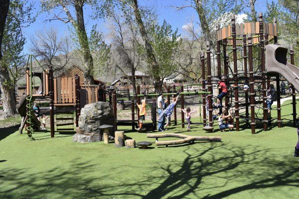 playground with turf, rocks, and climbing areas.
