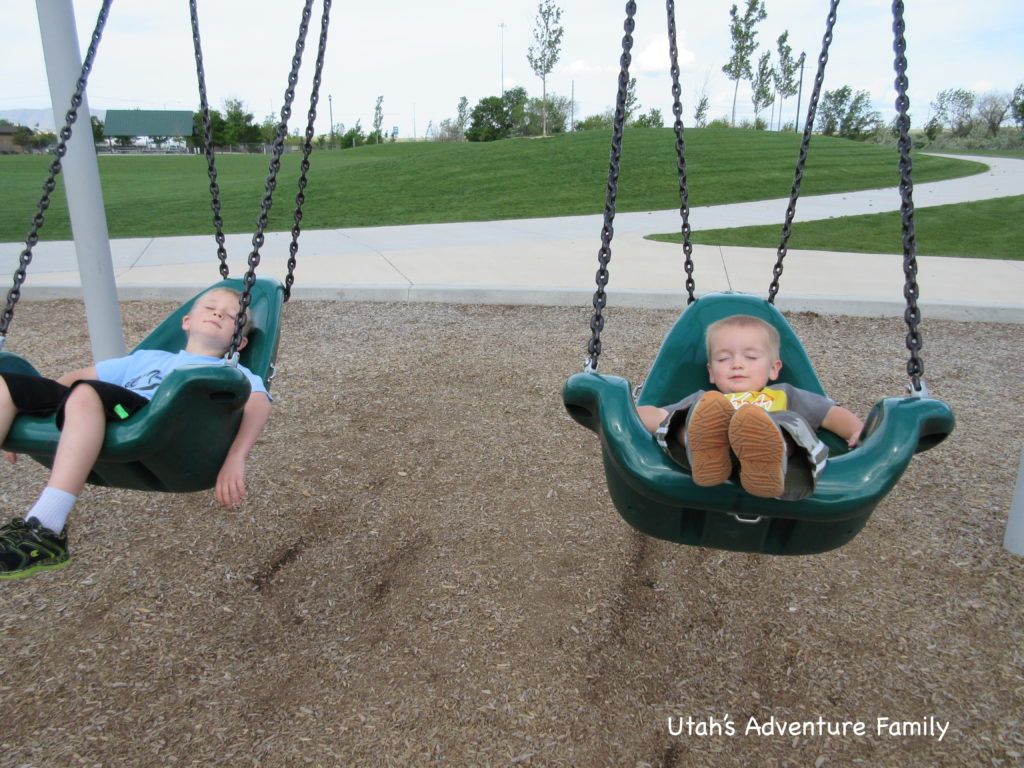 They loved riding in these big swings. I'm not sure why they are pretending to sleep.