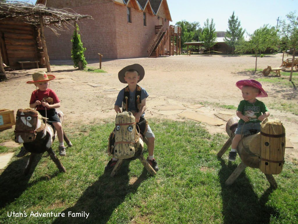The kids dressed up like cowboys and rode these horses.