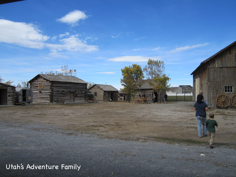 Some of the other buildings--two barns and some cabins.