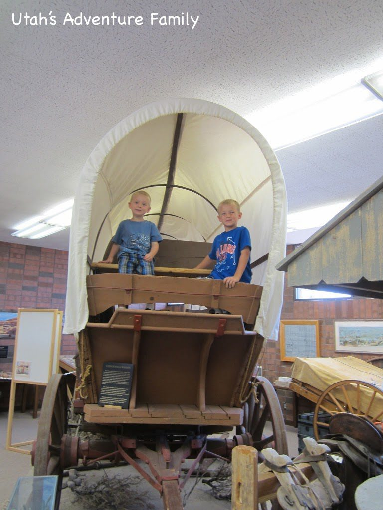The boys were lucky enough to sit in the wagon.
