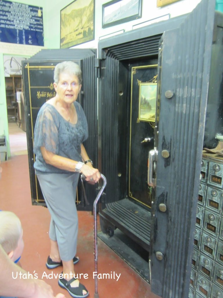 Our tour guide showing us the safe. Dad loved that there was cyanide inside that handle, if you messed with the lock, the cyanide capsule would break and uh oh!