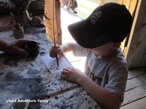 Our boys really liked writing a postcard with ink and a feather pen.
