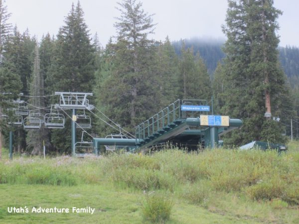 This ski lift is to the right of the trail.