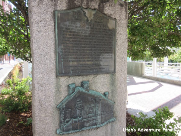 This stone marker explains the historical significance of the social hall.