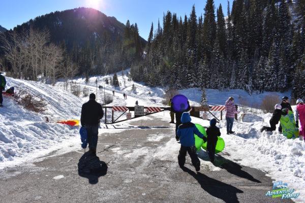 Sledding at Donut Falls - Utah's Adventure Family