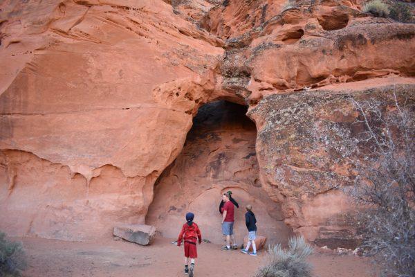 children hiking in red rocks